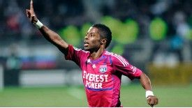 Michel Bastos celebrates scoring for Lyon
