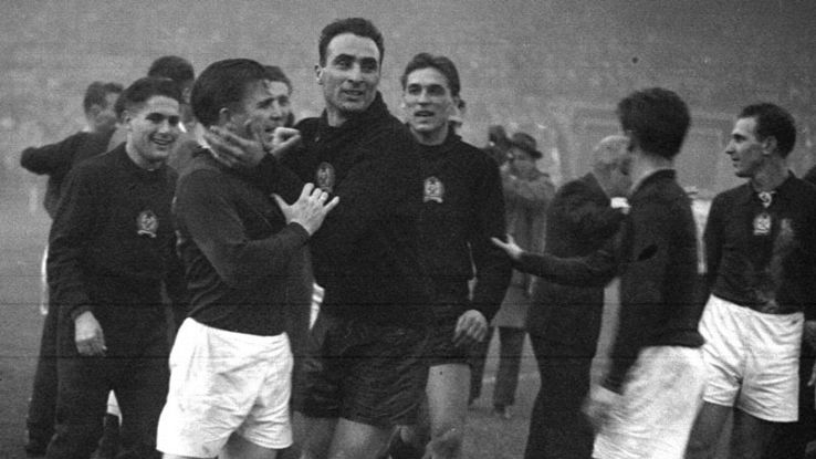 Puskas is congratulated at the end of the game by team-mates