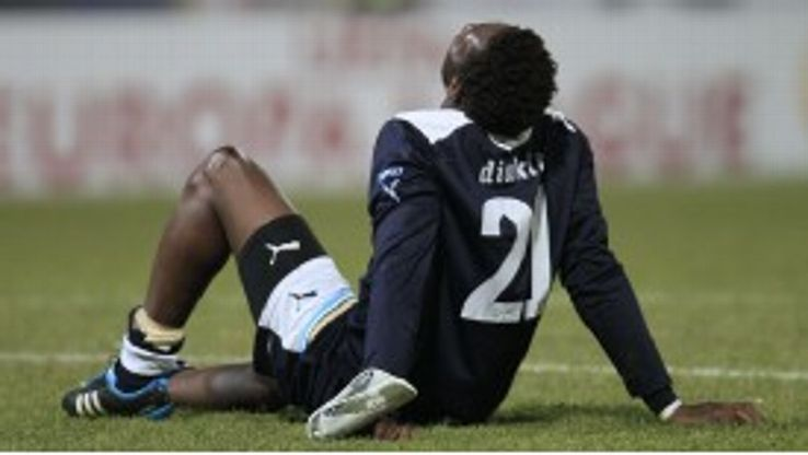 Modibo Diakite lies on the field at the end of Lazio's 0-0 draw with FC Vaslui