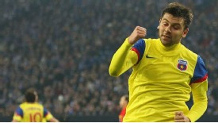 Raul Rusescu celebrates after netting an equaliser for Steaua Bucuresti against Schalke