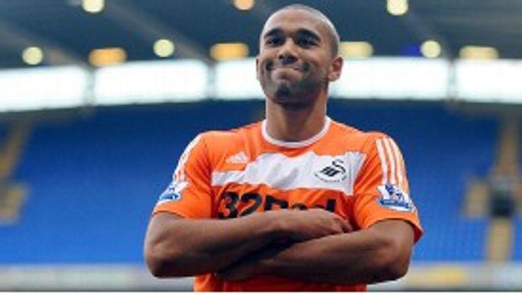 Luke Moore celebrates having put Swansea ahead against Bolton