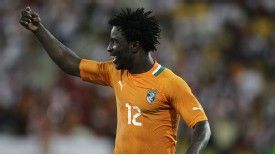 Wilfried Bony celebrates after doubling Ivory Coast's lead against Angola