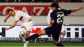 Zdravko Kuzmanovic of Stuttgart tries to score against Florian Dick of Kaiserslautern k Hamsik