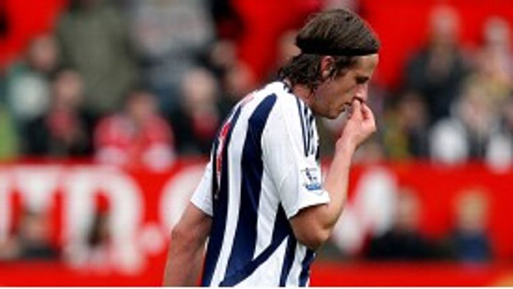 Jonas Olsson receives his marching orders following a challenge on Hernandez