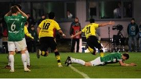 Ilkay Gundogan celebrates the only goal - an own goal - in Dortmund's cup semi-final
