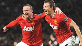 Wayne Rooney celebrates with supplier Jonny Evans