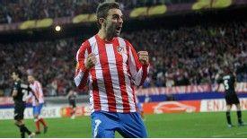 Adrian Lopez celebrates scoring Atletico Madrid's third goal
