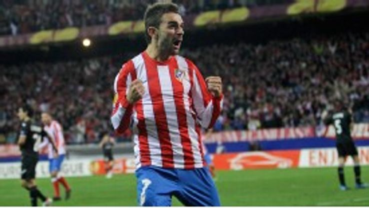 Adrian Lopez celebrates scoring Atletico Madrid's third goal