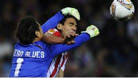 Atletico Madrid forward Radamel Falcao vies with Valencia goalkeeper Diego Alves