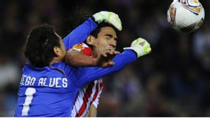 Atletico Madrid forward Radamel Falcao vies with Valencia goalkeeper Diego Alves