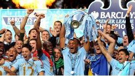 Manchester City players celebrate winning the Premier League