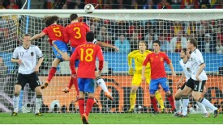 Carles Puyol heads home the winning goal for Spain against Germany at the 2010 World Cup
