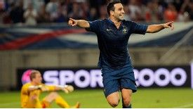 France defender Adil Rami celebrates his late winner against Iceland