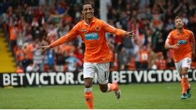 Thomas Ince celebrates after scoring for Blackpool