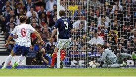Scotland's Allan McGregor saves from a shot by Serbia's Branislav Ivanovic