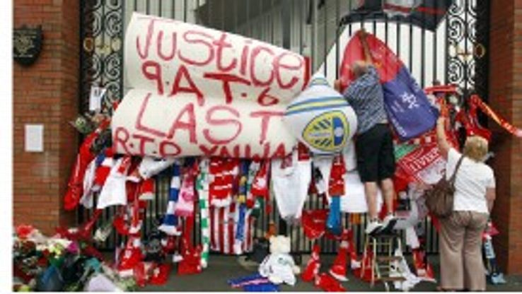 Tributes are placed on the Shankly Gates next to the Hillsborough memorial