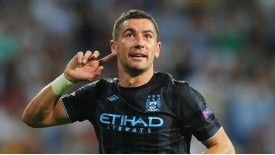 Aleksandar Kolarov celebrates after restoring Manchester City's lead