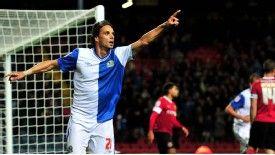 Nuno Gomes celebrates scoring the winning goal for Blackburn