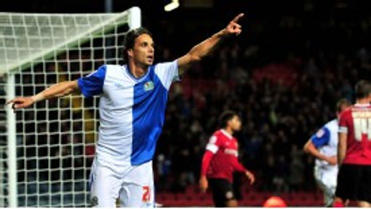 Nuno Gomes celebrates scoring the winning goal for Blackburn