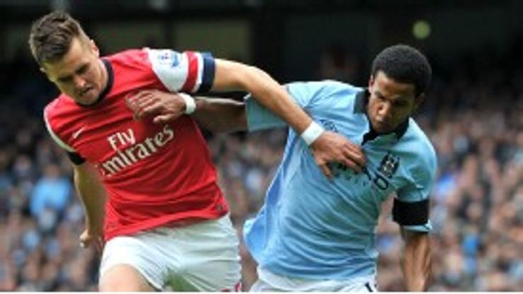 Carl Jenkinson and Scott Sinclair battle for the ball