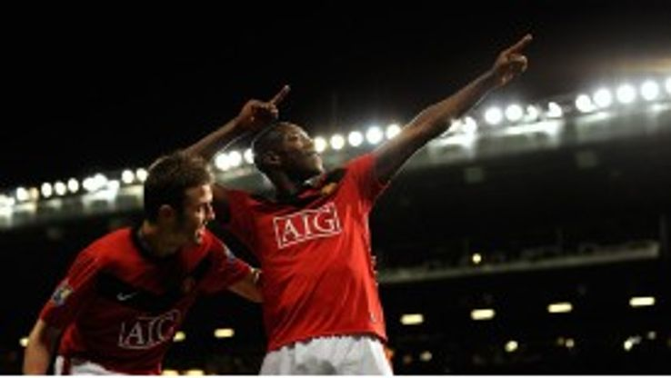 Michael Carrick and Danny Welbeck celebrate a goal for Man United