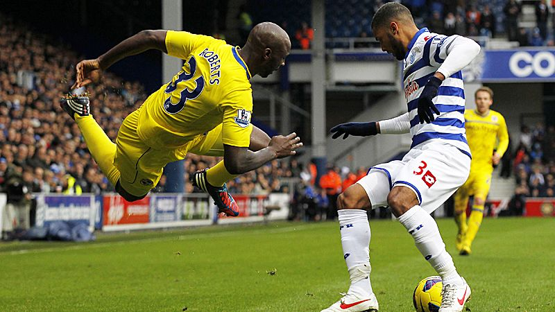 Jason Roberts is sent into the air following a challenge by Armand Traore