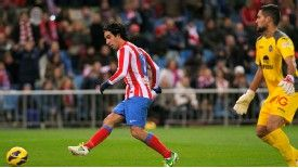 Arda Turan slots the ball home for Atletico