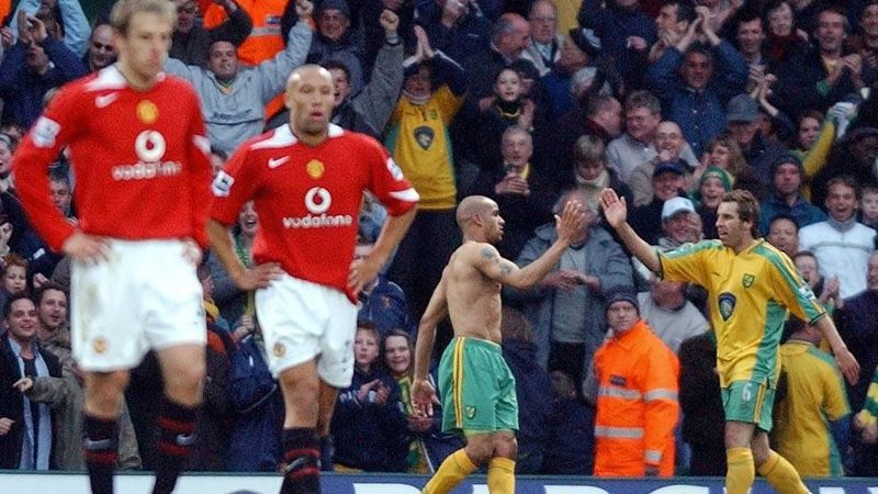Leon McKenzie and Darren Huckerby celebrate after Norwich scored against Man United