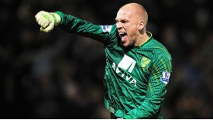 John Ruddy celebrates Anthony Pilkington's recent winner against Man United