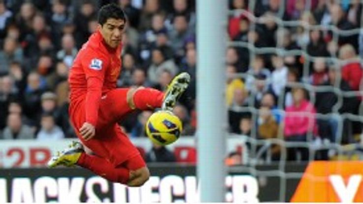 Luis Suarez jumps for the ball