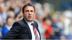 Malky Mackay's Cardiff were promoted to the Premier League as Championship champions