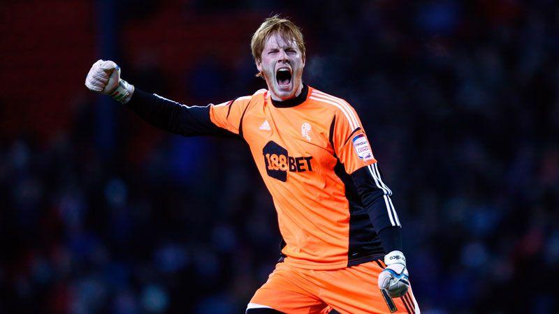 Adam Bogdan celebrates Bolton's opener