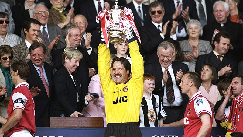 David Seaman lifts the FA Cup in 1998