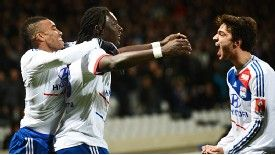Lyon celebrate after Bafetimbi Gomis scored what proved to be Lyon's winner at home to Montpellier
