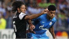 Malaga's Martin Demichelis (left) and Zenit St Petersburg's Hulk battle for the ball