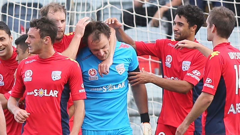 Adelaide United Galekovic is congratulated after saving a penalty