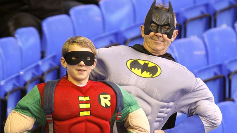 Two fans at Goodison Park get into the festive spirit by dressing up as Batman and Robin