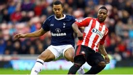 Tottenham's Mousa Dembele vies for the ball with Sunderland's Stephane Sessegnon