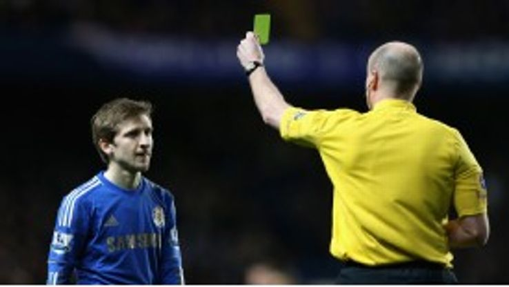 On his Premier League debut Marko Marin is lucky to escape with just a caution after fouling QPR's Stephane Mbia
