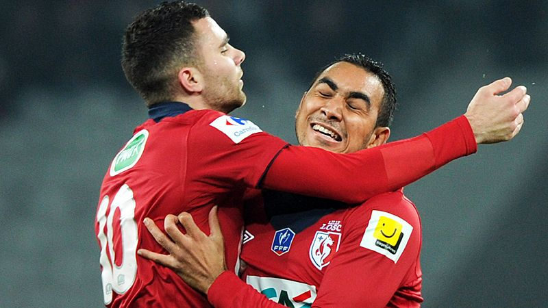 Marvin Martin and Dimitri Payet celebrate as Lille progress with victory over Nimes