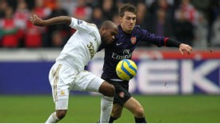 Aaron Ramsey and Dwight Tiendalli battle for the ball