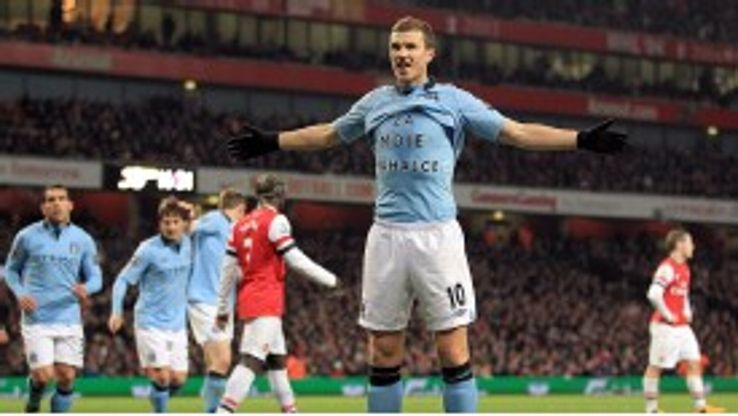 Dzeko celebrates his goal against Arsenal