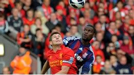 Maurice Edu challenges Steven Gerrard for the ball in a rare outing for Stoke