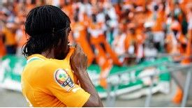 Gervinho kisses the Ivory Coast badge after netting the late winner