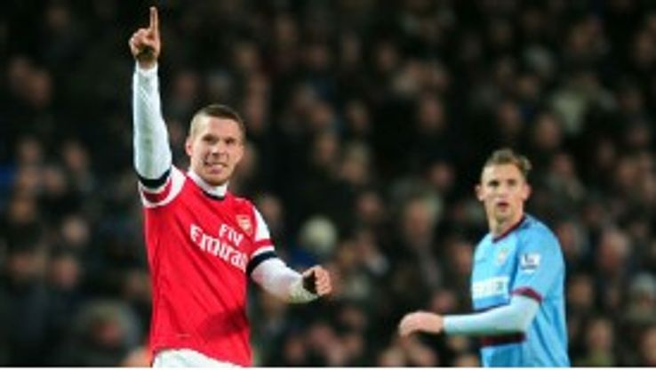 Lukas Podolski celebrates after netting the equaliser