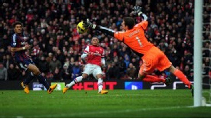 Asmir Begovic saves a shot from Alex Oxlade-Chamberlain
