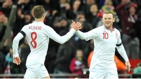 Wayne Rooney celebrates with Jack Wilshere after giving England the lead