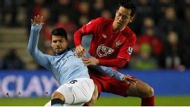 Maya Yoshida battles for possession with Sergio Aguero