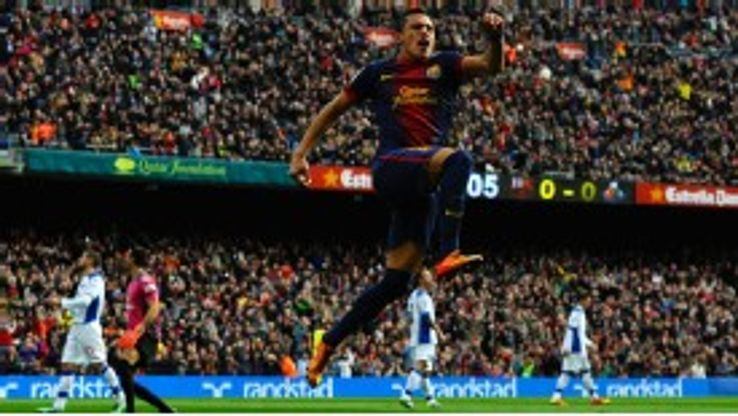 Alexis Sanchez celebrates giving Barcelona the early lead against Getafe