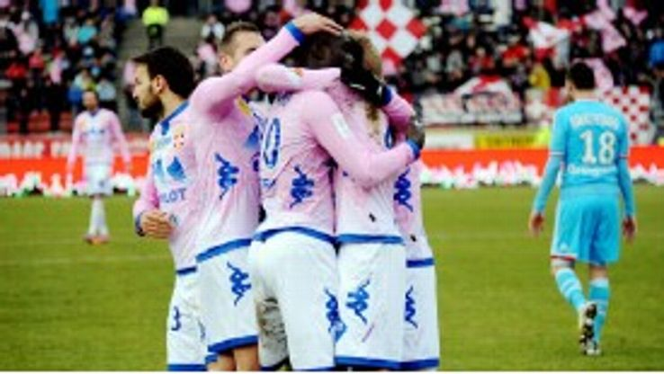 Yannick Sagbo celebrates after netting for Evian to deny Marseille